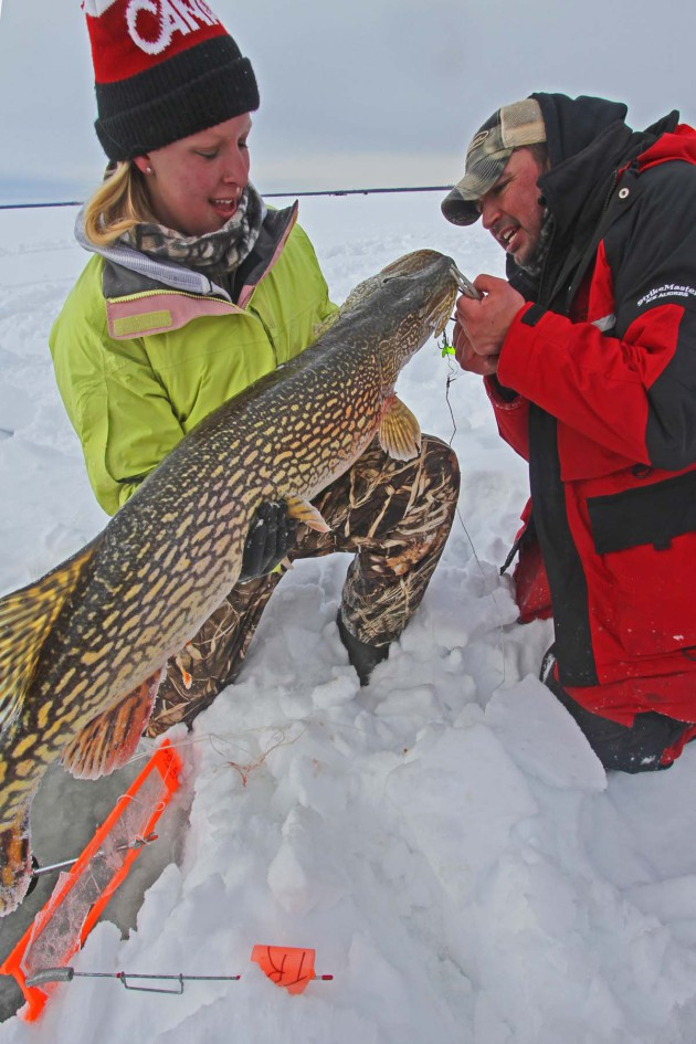 youth-with-northern-pike-fish